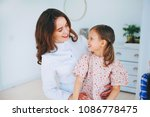 little girls trust a young... | Shutterstock . vector #1086778475