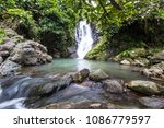 waterfall along the trail of... | Shutterstock . vector #1086779597