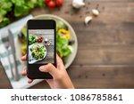 food blogger using smartphone... | Shutterstock . vector #1086785861
