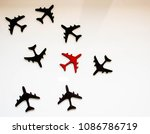 Small photo of Black and red aircraft seen from above to signify anti collision or airspace traffic.