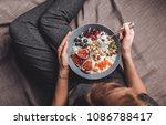woman in home clothes eating... | Shutterstock . vector #1086788417
