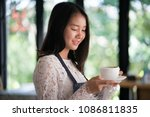 asian women barista smiling  in ... | Shutterstock . vector #1086811835