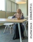 a beautiful muslimah student... | Shutterstock . vector #1086825911