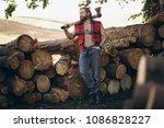 lumberjack in forest | Shutterstock . vector #1086828227