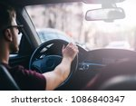 young man driving a business... | Shutterstock . vector #1086840347