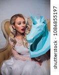 freaky blonde girl and unicorn... | Shutterstock . vector #1086855197