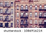 old buildings with fire escapes ... | Shutterstock . vector #1086916214