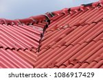 the red roof was damaged by the ...   Shutterstock . vector #1086917429