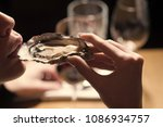woman eating shellfish. seafood ... | Shutterstock . vector #1086934757
