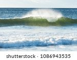 small beach break shore break... | Shutterstock . vector #1086943535
