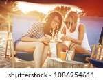 two young casual female friends ... | Shutterstock . vector #1086954611