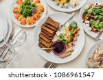 served dishes to the table for... | Shutterstock . vector #1086961547