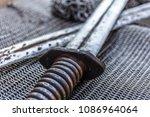 crossed swords on chain armor ... | Shutterstock . vector #1086964064