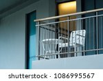 table chair on the balcony... | Shutterstock . vector #1086995567