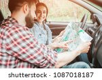 young couple is sitting in car. ... | Shutterstock . vector #1087018187