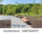 wooden bench in a summer park... | Shutterstock . vector #1087036997