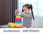 children girl play a toy games... | Shutterstock . vector #1087054691