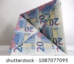 Small photo of 20 euro banknotes folded to form a self-supporting triangular structure