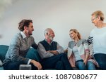 young couple talking with their ... | Shutterstock . vector #1087080677