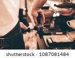 close up barista hand making a... | Shutterstock . vector #1087081484