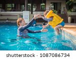 mother and son are enjoying... | Shutterstock . vector #1087086734