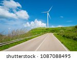 wind turbine at the end of a... | Shutterstock . vector #1087088495