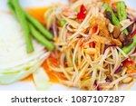 papaya salad is a popular thai ...   Shutterstock . vector #1087107287