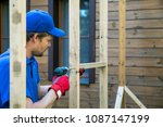 man is building a shed in... | Shutterstock . vector #1087147199