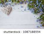 forget me nots and heart on a... | Shutterstock . vector #1087188554