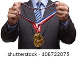 Businessman giving gold medal prize for success in business - stock photo