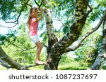 child girl playing climbing on...   Shutterstock . vector #1087237697