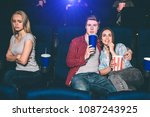beautiful couple is sitting... | Shutterstock . vector #1087243925