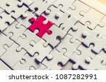 Stock photo a pieces of jigsaw puzzle will be matching business concept red and white puzzles 1087282991