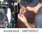 repairing motorbike.... | Shutterstock . vector #1087333517