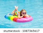 happy child on inflatable ice...   Shutterstock . vector #1087365617
