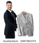 young businessman holding... | Shutterstock . vector #1087381574