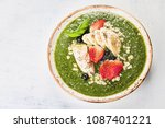 green smoothie bowl with fresh... | Shutterstock . vector #1087401221