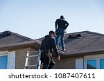 two roofers inspecting a... | Shutterstock . vector #1087407611