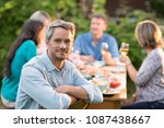 looking at the camera  a man in ... | Shutterstock . vector #1087438667