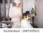 a woman wearing a perm | Shutterstock . vector #1087439021