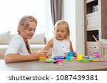 mother and daughter playing... | Shutterstock . vector #1087439381