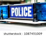 police vehicle sign with blue... | Shutterstock . vector #1087451009