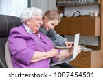 a 95 year old woman is holding...   Shutterstock . vector #1087454531