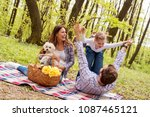 happy parents enjoying picnic... | Shutterstock . vector #1087465121