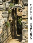 Small photo of Ruined stone arch in ancient Greek ruins