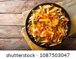 freshly cooked french fries... | Shutterstock . vector #1087503047