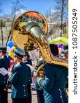 Small photo of Florence, Tuscany / Italy. - March 9, 2018. Performance of the brass band at the city festival. Musicians with french horn, trumpet, trumpet, saxophone, clarinet