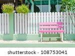 Pink Wooden Bench In Front Of...