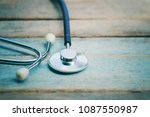 close up stethoscope on old... | Shutterstock . vector #1087550987