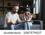 bewildered man looking at... | Shutterstock . vector #1087579037